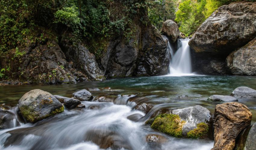 Mental resilience water flowing around rock